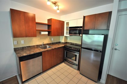 Designer Kitchen Cabinetry With Stainless Steel Appliances.