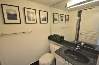Main Bath With A Full Size Mirror, 3-Piece & Black Ceramic Flooring.