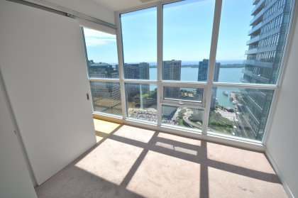 2nd Bedroom With Floor-To-Ceiling Windows Facing Spectacular Lake Views.