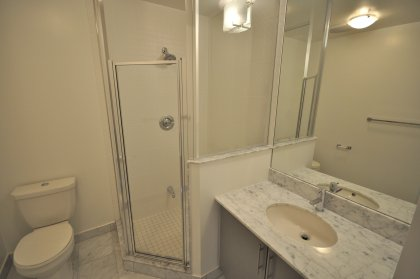 Main Bath With 3-Piece & Upgraded Marble Counter Tops & Flooring.
