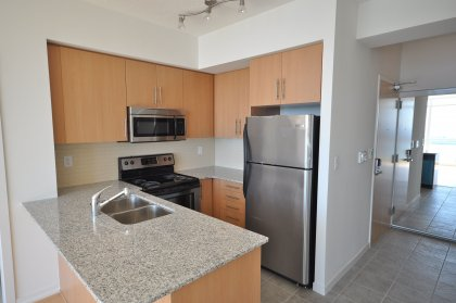 Designer Kitchen Cabinetry With Stainless Steel Appliances, Granite Counter Tops, Undermounted Sink & A Breakfast Bar.