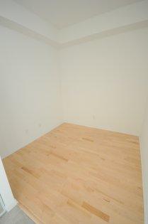 Den With Hardwood Flooring.