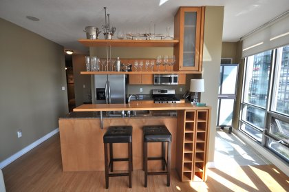 Designer Kitchen Cabinetry With Stainless Steel Appliances, Granite Counter Tops, Breakfast Bar & A Built-In Wine Rack.