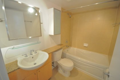 Main Bath With Granite Counter Tops, Adjustable Mirror & Glass Shelving.