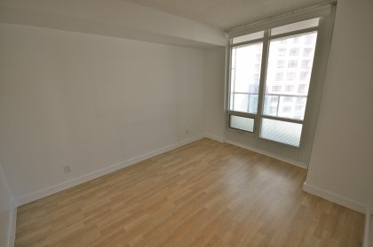 Bright & Spacious Sized Master Bedroom With Laminate Flooring Throughout.