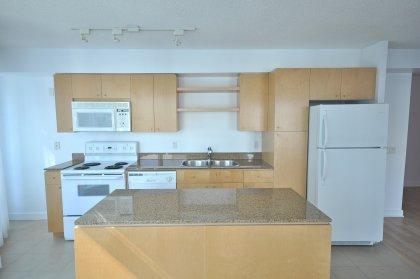 Designer Kitchen Cabinetry, Granite Counter Tops, Track Lighting & A Center Island.
