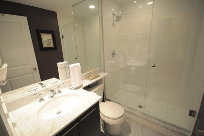 Main Bath With 3-Piece Frameless Glass Shower, Full Sized Mirror, Marble Counter Top & Flooring.