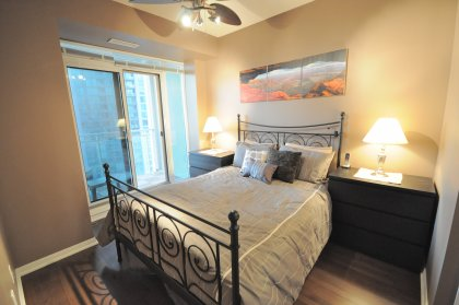 Master Bedroom With 4-Piece Ensuite, Gleaming Hardwood Flooring, Walk-In Closets & A Private Balcony Overlooking The Lake.