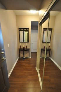 Suite Foyer With Mirrored Closets, Hardwood Flooring & Designer Paint Colours.