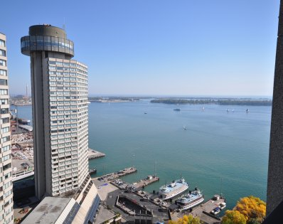 Stunning Lake Views Of Toronto's Landmark Westin Harbour Castle Hotel, The Inner Harbourfront & Centre Island.