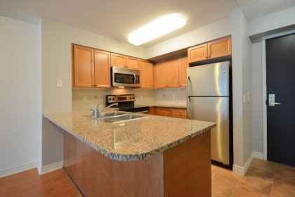 Designer Kitchen Cabinetry, Stainless Steel Appliances, Granite Counter Tops & Breakfast Bar.