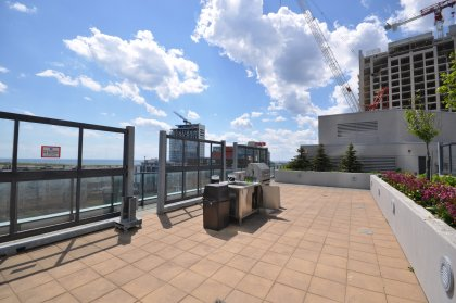Outdoor Roof Top Patio With B.B.Q. & Tanning Deck Area Overlooking Lake Views.