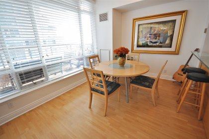 Spacious Sized Dining Area With Laminate Flooring Throughout And Window Lake Views.