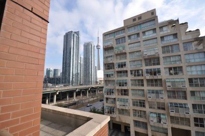 Gorgeous CN Tower & Lake Views From The Large Wooded Floor Private Balcony.