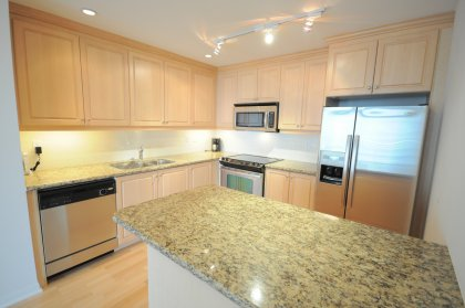 Designer Kitchen Cabinetry With Stainless Steel Appliances, Granite Counter Tops, Undermount Sink, Valance Lighting & Breakfast Bar.