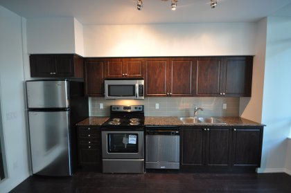 Designer Kitchen Cabinetry, Stainless Steel Appliances, Granite Counter Tops & Laminate Flooring.