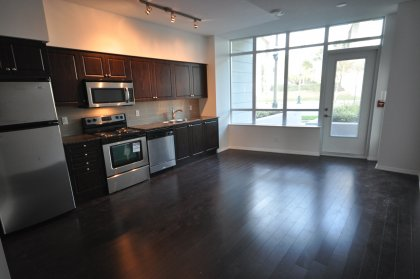 Designer Kitchen Cabinetry, Stainless Steel Appliances, Granite Counter Tops & Laminate Flooring With A Walk-Out.