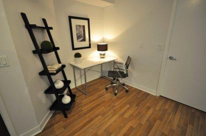Open Concept Den Area With Laminate Flooring.
