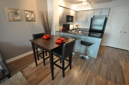 Open Concept Dining & Living Areas With Laminate Flooring & Gorgeous City Views.