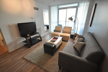 Open Concept Living & Dining Areas With Laminate Flooring & Gorgeous City Views.