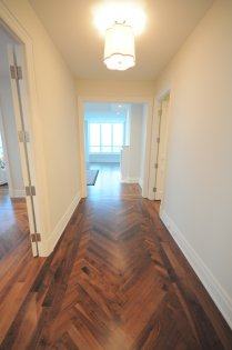 Gallery Area With Gleaming Hardwood Flooring.