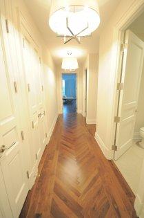 Hallway To Bedroom, Kitchen & Powder Rooms.