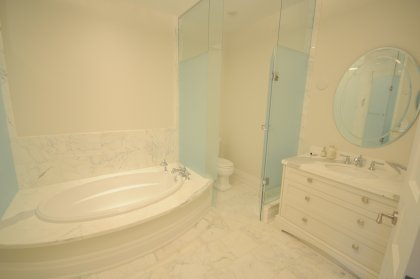 Master Bedroom 5-Piece Ensuite With Frameless Spa Shower, A Soaker Tub & Heated Marble Flooring.