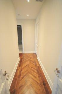 Double Door Master Bedroom Entrance With Pot Lighting, Hardwood Flooring & 2 Walk-In Closets,