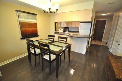 Open Concept Dining Area With Laminate Flooring Throughout Facing Gorgeous West & Sunset Views.