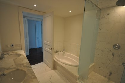 Master Bedroom 5-Piece Ensuite With Frameless Spa Shower And A Soaker Tub.