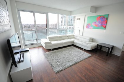 Open Concept Living Areas With Floor-To-Ceiling Windows, Laminate Flooring & 3 Walk-Outs To The Large Balcony.