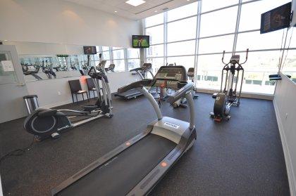 11th Floor Harbour Club Amenities. Fitness Room Overlooking Park Views.