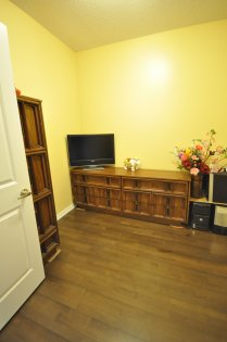 Spacious Sized Den Can Be Used As A 2nd Bedroom Or Home Office With Private Double Doors And Hardwood Flooring.