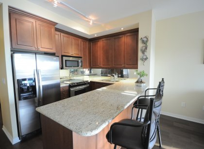 Gorgeous Designer Kitchen Cabinetry With Stainless Steel Appliances, Granite Counter Tops, Undermount Sink & Valance Lighting.