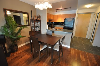 Open Concept Living/Dining Areas With Hardwood Flooring Throughout.