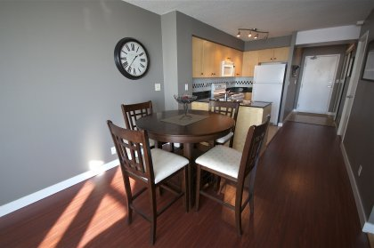 Spacious Sized Dining Area With Laminate Flooring Throughout.