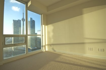 Spacious Bedroom With C.N. Tower & Lake Views.