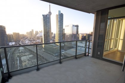 Premium Wrap Around Balcony Onlooking Stunning C.N. Tower & Lake Views.