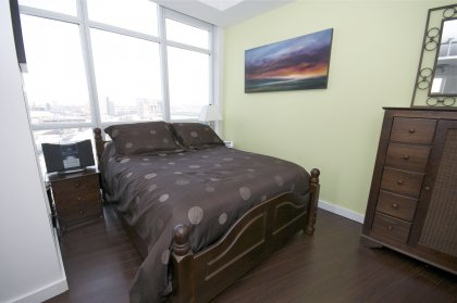 Master Bedroom With A 4-Piece Spa Bathroom, Sliding Door & Gleaming Hardwood Flooring Throughout With Lake Views.