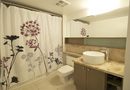 Main Bath With 4-Piece Ensuite & Laundry Area.