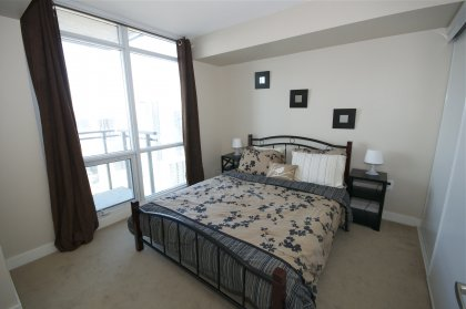 Spacious Sized Master Bedroom With Wall-To-Wall Closets Onlooking Stunning Unobstructed Lake & Island Views.