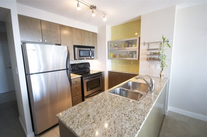 Designer Kitchen Cabinetry With Stainless Steel Appliances, Granite Counter Tops & Undermount Lighting.