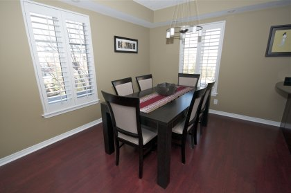 Bright Open Concept Dining Area With Natural Lighting, Designer Paint Colours, California Shutters & Laminate Flooring Thoughout.