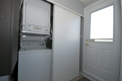 Upper Level Laundry Area With A Walk-Out To The Outdoor Rooftop Oasis.