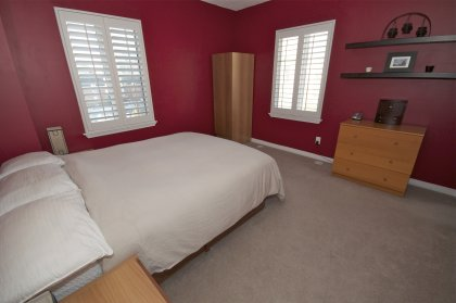 Bright & Spacious Sized Master Bedroom With Designer Paint Colours, California Shutters & A Walk-In Closet.