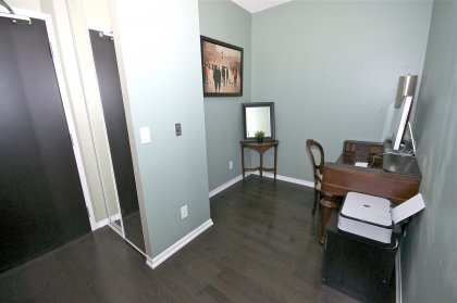 Spacious & Private Den Area With Hardwood Flooring.