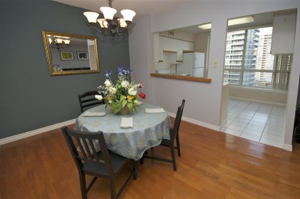Spacious Dining Areas With Gleaming Hardwood Flooring Facing East Park Views.