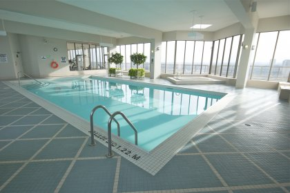 Indoor Pool And Jacuzzi With Oudoor Tanning Deck Facing Incredible City & Lake Views