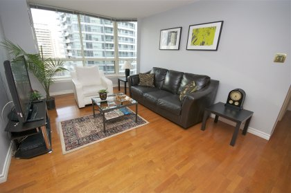 Spacious Living Area With Gleaming Hardwood Flooring Facing East Park Views.