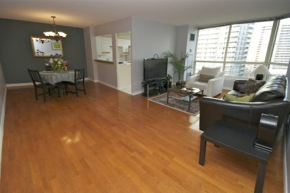 Open Concept Living & Dining Areas With Gleaming Hardwood Flooring Facing East Park Views.